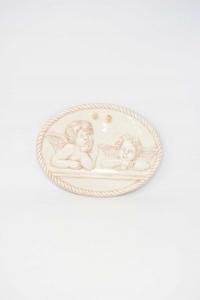 Quadretto In Ceramica Coppia Angioletti Pensanti Forma Ovale Da Appendere 17 X 23 Cm