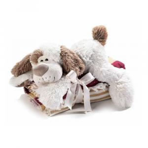 Cagnolino sdraiato di peluche con coperta a righe bicolore