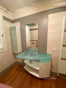 Bathroom With Glass Plane + Shelves And Cabinet With Door